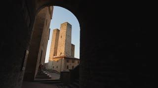 POV WS Walking down Narrow Alley to San Gimignano Piazza / Tuscany, Italy
