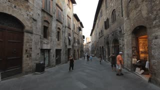 POV WS Walking down Old Town Street / Tuscany, Italy