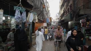 REAR POV WS Busy market street / New Delhi, India