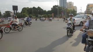 REAR POV WS Motorcycle Traffic Along Busy Street / Ho Chi Minh, Vietnam