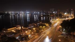 T/L WS HA LD Traffic on Busy Street Next to Saigon River at Night / Ho Chi Minh, Vietnam