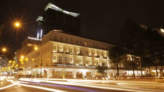 T/L WS LD Traffic in front of Hotel Continental Saigon at Night / Ho Chi Minh, Vietnam