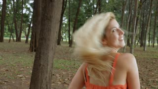 TS MS POV Young woman running through forest