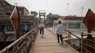 WS Bicyclist and People Walking down Wooden Bridge / Ho Chi Minh, Vietnam