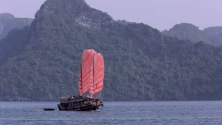 WS Boat with red sails in bay / Ha Long Bay, Vietnam