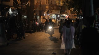 WS Busy street scene at night / India
