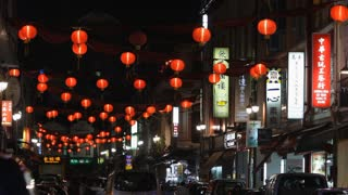 WS Chinese lanterns hanging above street at night / Chinatown, Singapore