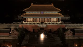 WS Chinese temple rooftop with city skyline in background at night / Beijing, China