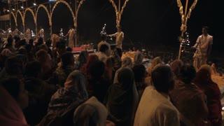 WS Crowd of people watching Aarti Puja ceremony / Varanasi, India