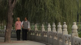 WS Elderly couple walking through park together / China