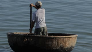 WS Fisherman Rowing in Sea in Traditional Round Boat / Vietnam