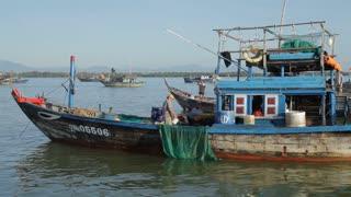 WS Fisherman Working on His Boat / Vietnam