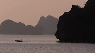 WS Fishing Boat at dusk in Ha Long Bay / Vietnam