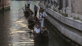 WS Gondoliers Rowing Gondolas down Grand Canal / Venice, Italy