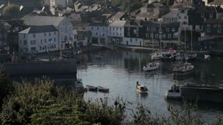 WS HA Boat Floating in Harbour with Houses on Hillside / Cornwall, England, UK