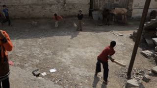 WS HA Children playing cricket in backyard / India