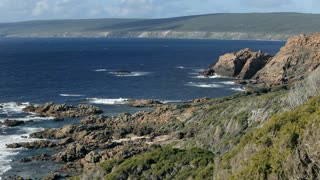 WS HA Clifs and rocky terrain overlooking sea / Australia
