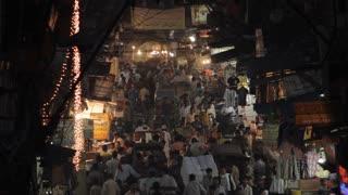 WS HA Crowded street scene at night / New Delhi, India