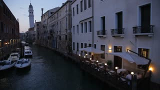 WS HA LD Boats Moored in Canal Next to Cafe at Night / Venice, Italy