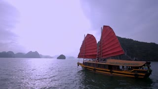 WS Junk boat with red sails in bay / Ha Long Bay, Vietnam
