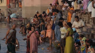 WS Large group of people bathing in Ganges river / Varanasi, India