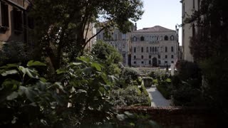 WS LD Boat Going by in front of Buildings with Courtyard in Foreground / Venice, Italy