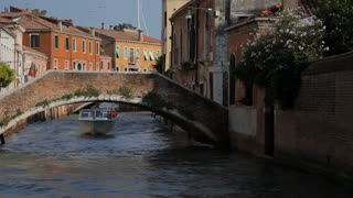 WS LD Boat Going under Bridge in Canal / Venice, Italy