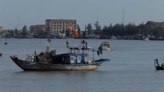 WS LD Fishermen in Traditional Round Boats Rowing by Boats on Water / Hoi An, Vietnam