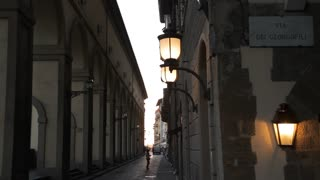 WS LD Motorcycle Going down Narrow Street / Florence, Italy