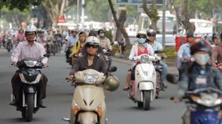 WS LD Motorcycle Traffic Along Busy Street / Ho Chi Minh, Vietnam
