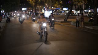 WS LD Motorcycle Traffic Going down Busy Road at Night / Ho Chi Minh, Vietnam