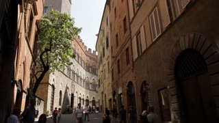 WS LD People Walking down Narrow Street Between Buildings / Tuscany, Italy