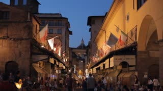 WS LD People Walking down Street with Flags Hanging from Buildings / Florence, Italy