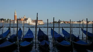 WS LD Row of Gondolas Moored in Water / Venice, Italy