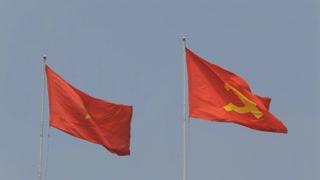 WS LD Vietnamese and Communist Flags Waving / Ho Chi Minh, Vietnam