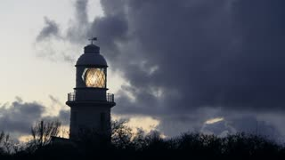 WS Light circling in lighthouse against dark sky