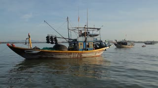 WS Man Prepping His Fishing Boat / Vietnam