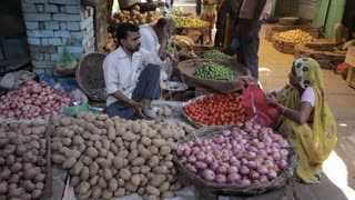 WS Man selling vegetables in market / India