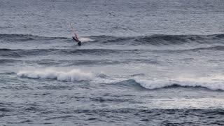 WS Man windsurfing on wave