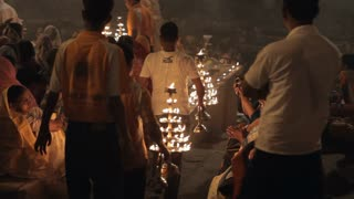 WS Men carrying out oil lamps for Aarti Puja ceremony / Varanasi, India