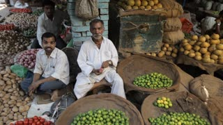 WS Men selling vegetables and fruit in market / India