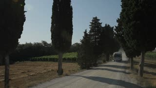 WS Motor home driving up dirt road / Tuscany, Italy