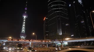 WS Oriental Pearl Tower with traffic in foreground at night / Shanghai, China