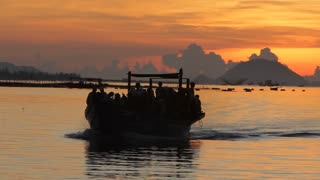 WS PAN Boat Filled with People Going by at Sunset / Vietnam