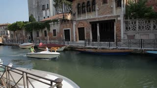 WS PAN Boat Going down Canal / Venice, Italy
