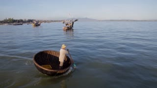 WS PAN Fisherman Rowing by in Traditional Round Boat / Hoi An, Vietnam