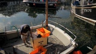 WS PAN Fisherman Working on Boat / Cornwall, England, UK