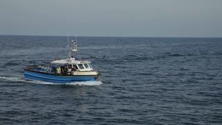 WS PAN Fishing Boat Going Past Lighthouse / Cornwall, England, UK