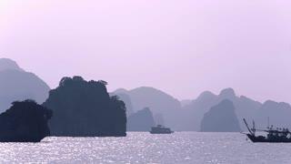 WS PAN Fishing boats in Ha Long Bay / Vietnam