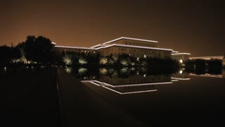 WS PAN Great Hall of the People next to National Grand Theater reflecting at lake at night / Beijing, China